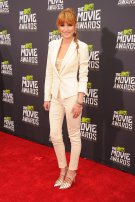 Bella Thorne stunns in a cream pantsuit