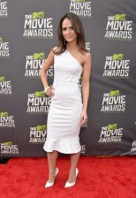 Jordana Brewster wears a white one shoulder dress