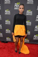 Kerry Washington wears a bright high-low skirt and black top
