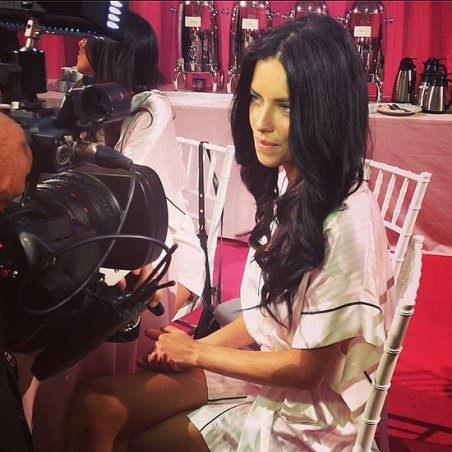 Adriana Lima backstage doing interviews